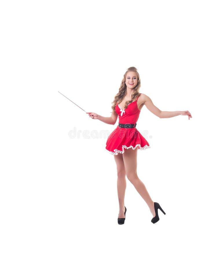 Сексуальное женское Санта развевает электрод как волшебная палочка стоковое фото