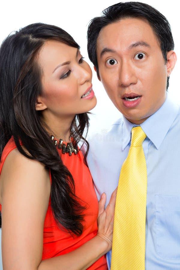 Сексуальные домогательства китайской женщиной в офисе стоковое изображение rf