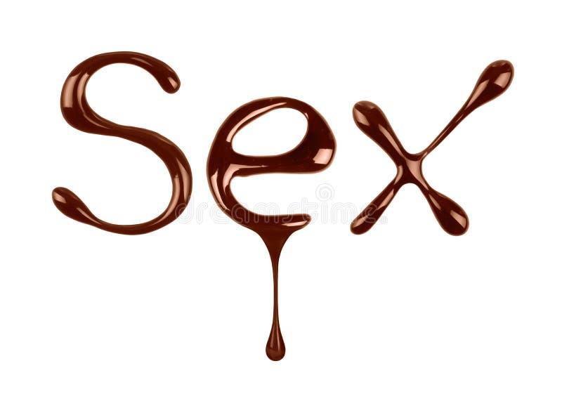 Секс слова написанный жидкостным шоколадом на белизне стоковые фото