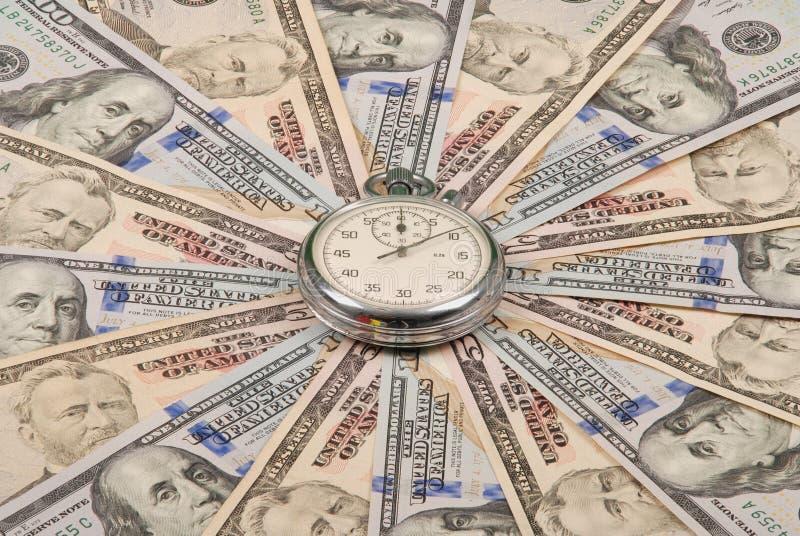 Секундомер на калейдоскопе мандалы от денег стоковое фото rf