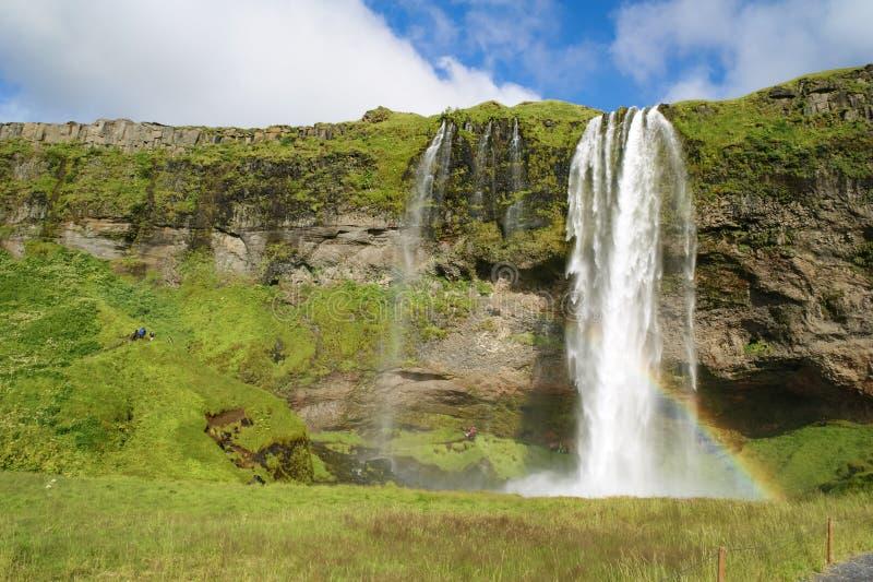 Сельяландсфосс водопад в реке Селяланд, каскад, расположенный на расстоянии 60 метров 197 футов, рядом с маршрутом 1 на юге Ислан стоковое фото rf