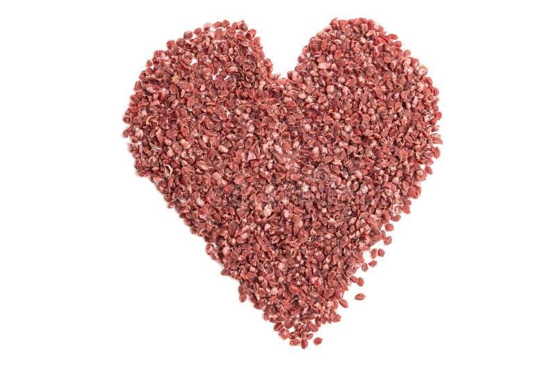Семена смородины для засевать на белой предпосылке в форме сердца стоковое фото