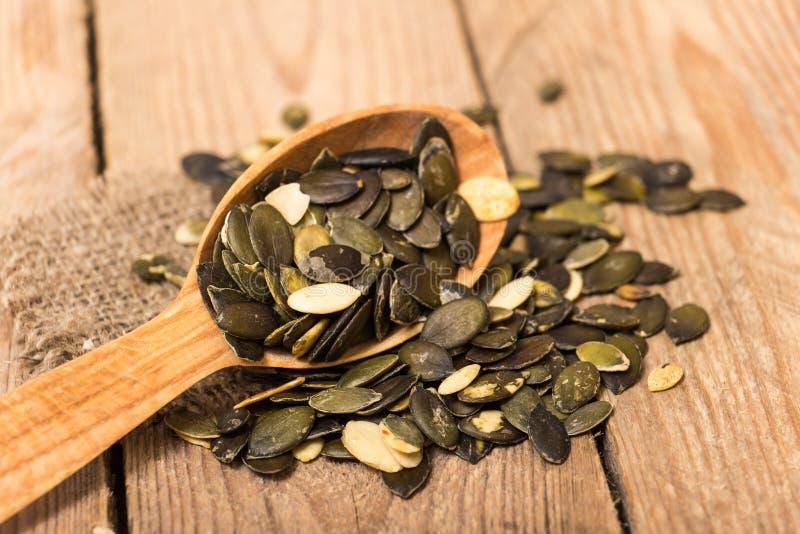семена тыквы еды предпосылки близкие вверх стоковые изображения
