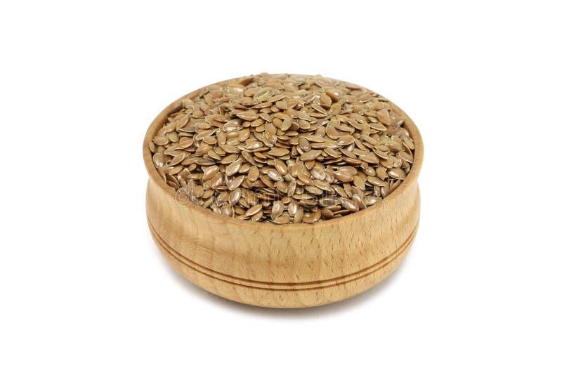 Семена льна Брайна в деревянном шаре стоковые фото