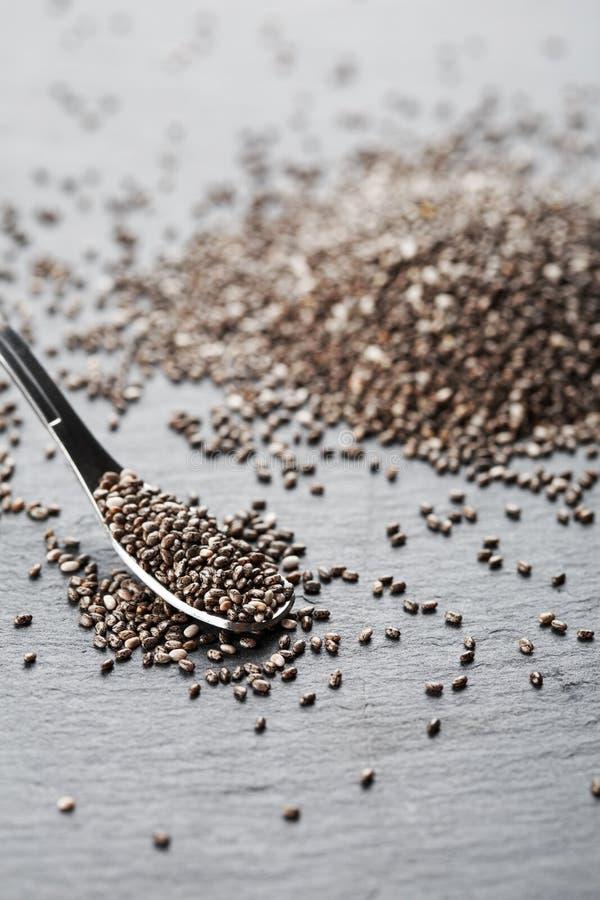 Семена Chia в ложке металла стоковое фото rf