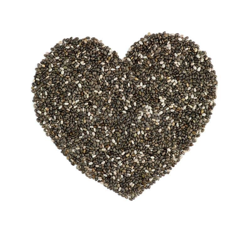 Семена Chia в форме сердца изолированные на белизне стоковое изображение