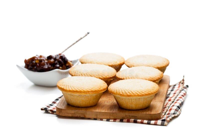 Семените группу пирога на разделочной доске на белизне стоковые фото