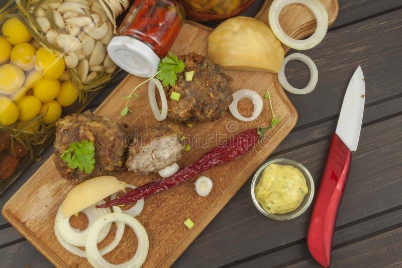 Семенить, зажаренные мясо и сыр стоковые изображения
