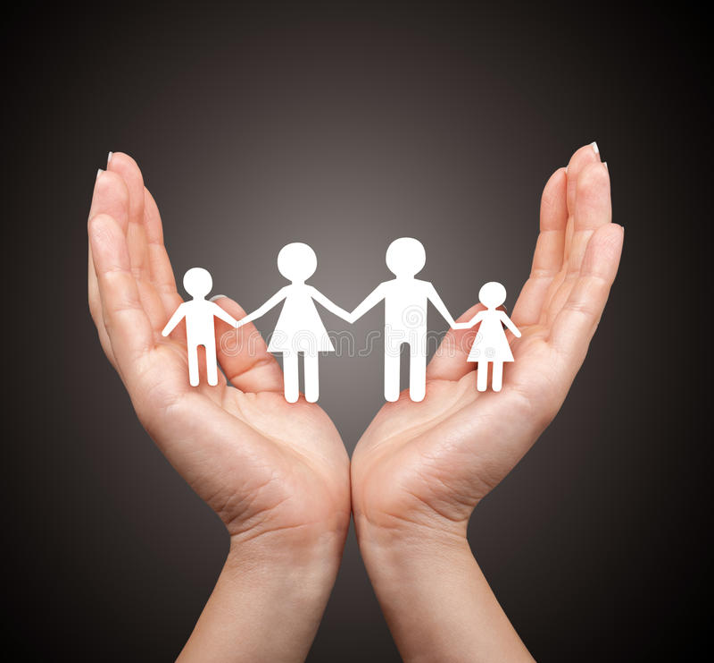 Семья в концепции ладони стоковые изображения rf