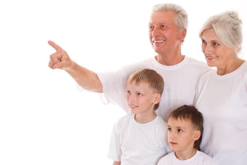 Семья из четырех человек совместно стоковое фото