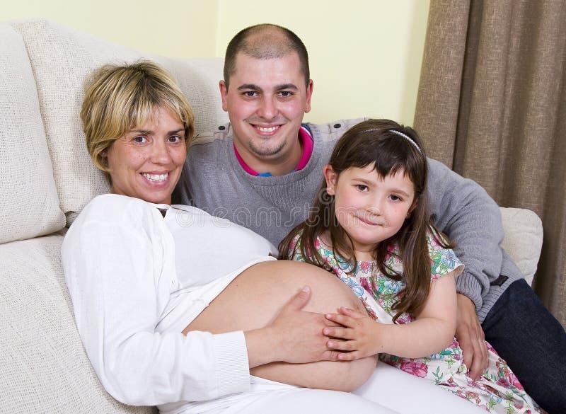 семья супоросая стоковое фото