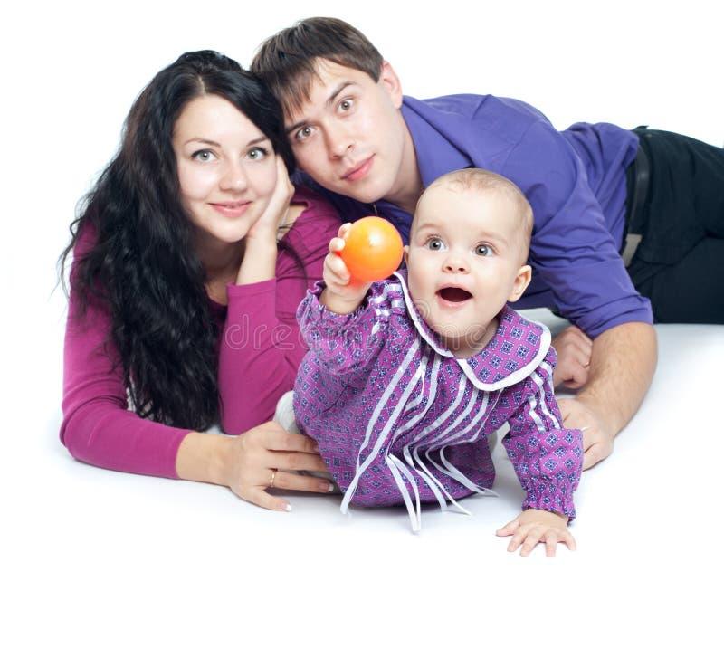 Семья с младенцем стоковое изображение