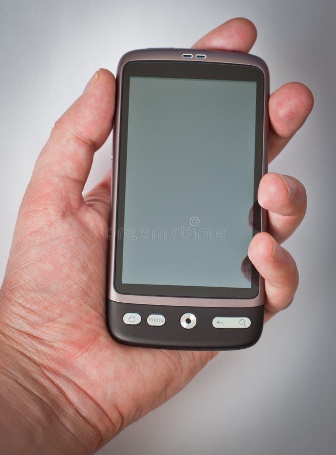 сенсорный экран smartphone руки стоковое фото