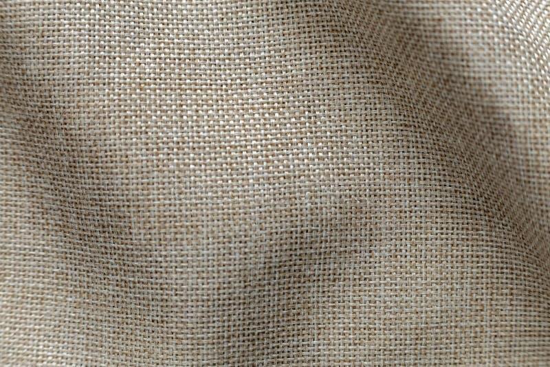 Серая бежевая предпосылка поверхности холста белья Дизайн дерюги, экологическая ткань хлопка, модная сплетенная мешковина гибкого стоковые фото