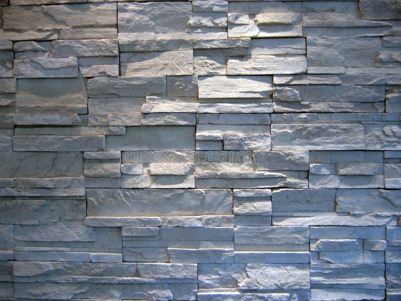 серая белизна каменной стены стоковое фото