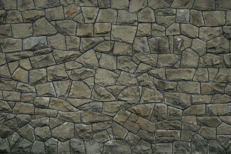 Серая зеленая предпосылка текстуры каменной стены r Поверхность зеленого гранита каменная Картина мозаики серых камней на цементе стоковое изображение