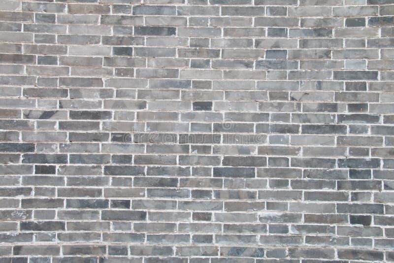 Серая кирпичная стена стоковое изображение