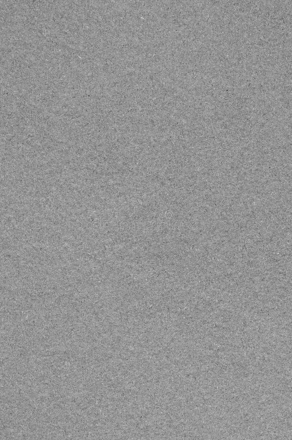 Серая текстура бумаги искусства картона альбома, вертикальная яркая грубая старая рециркулированная текстурированная пустая пуста стоковая фотография