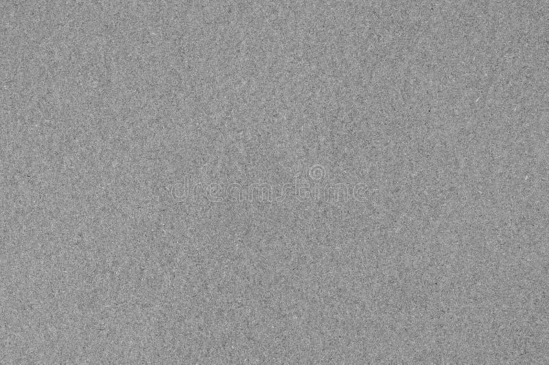 Серая текстура бумаги искусства картона альбома, горизонтальная яркая грубая старая рециркулированная текстурированная пустая пус стоковая фотография