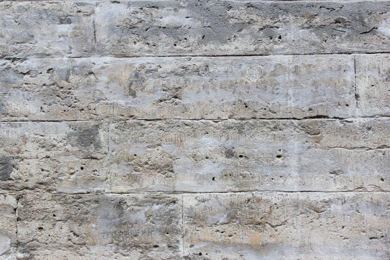 Серая текстурированная стена кирпичей стоковые фото