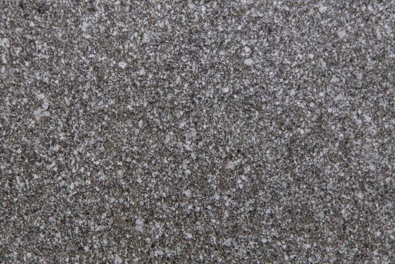 Серая черная белая поверхность камня гранита стоковые фото