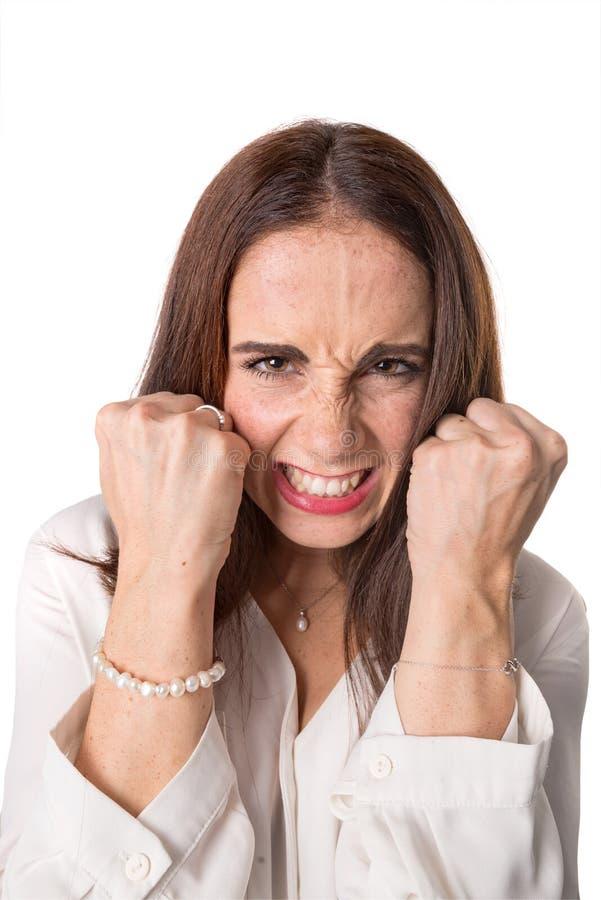 Сердитая вскользь молодая женщина стоковые изображения