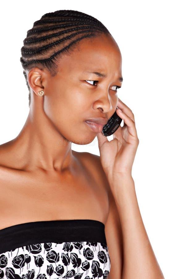 сердитая женщина телефона стоковое изображение rf