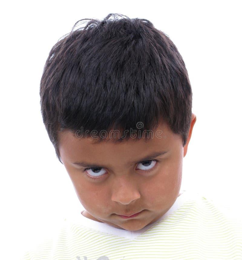 сердитые детеныши мальчика стоковое фото rf
