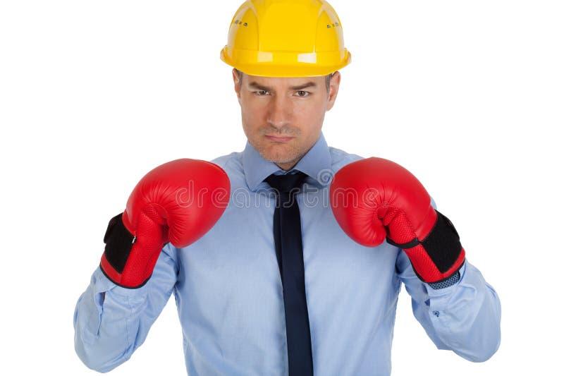 Сердитый архитектор с перчатками бокса стоковая фотография rf