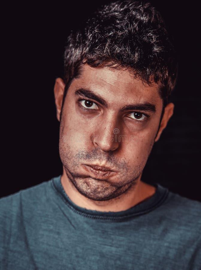Сердитый и уставший человек стоковое фото rf
