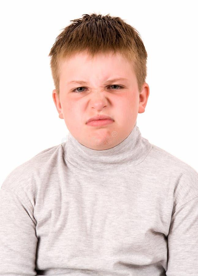сердитый мальчик немногая стоковое изображение