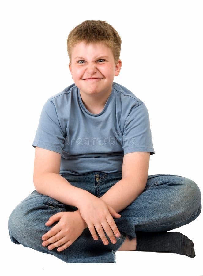 сердитый мальчик немногая стоковое фото