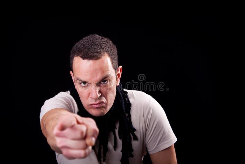 сердитый указывать человека стоковые изображения rf