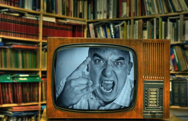 Сердитый TV-человек стоковые изображения rf