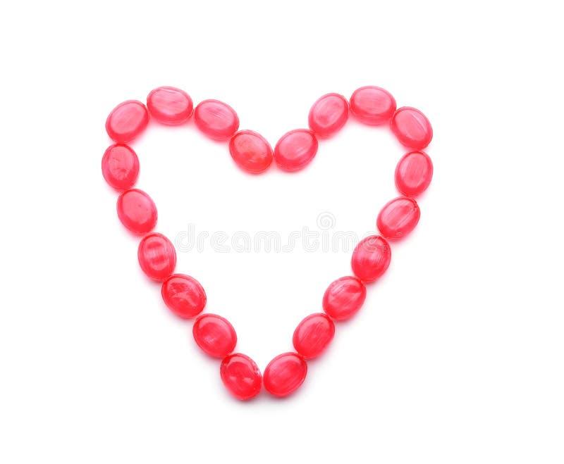 Сердце сделанное из сладких конфет на белой предпосылке стоковые изображения