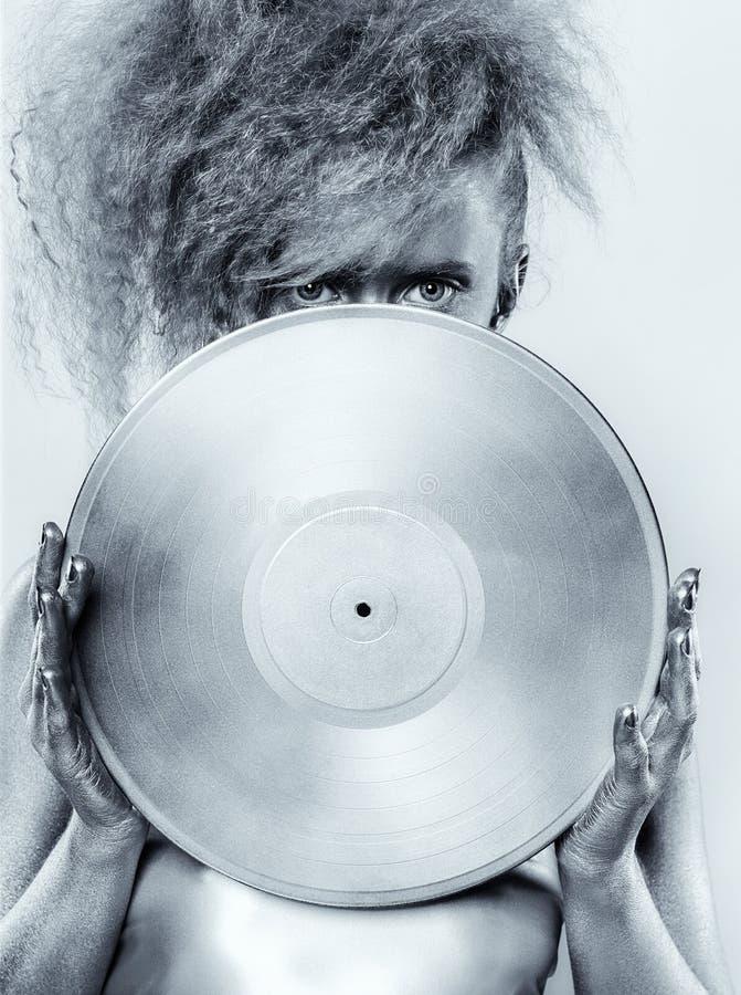 Серебряная девушка с винилом стоковое изображение