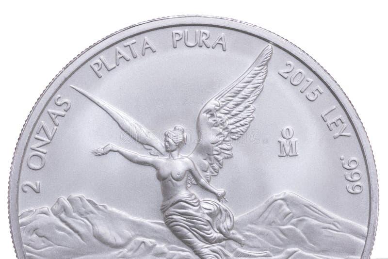 Серебряная монета мексиканца крупного плана стоковое фото
