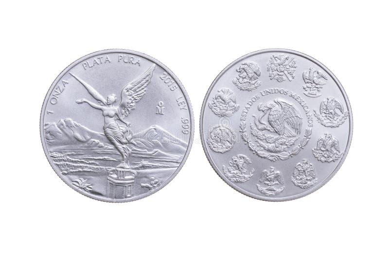 Серебряная монета мексиканца фронта и обратного стоковые изображения rf