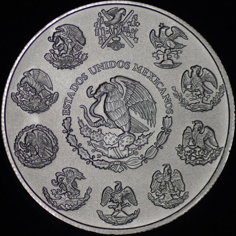 Серебряная монета Libertad мексиканца (обратный) стоковое изображение