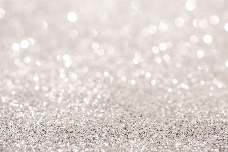 Серебряная предпосылка bokeh яркого блеска стоковая фотография