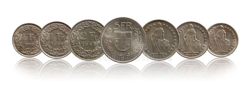 Серебряное монеток Швейцарии швейцарское изолированное на белой предпосылке стоковые фото
