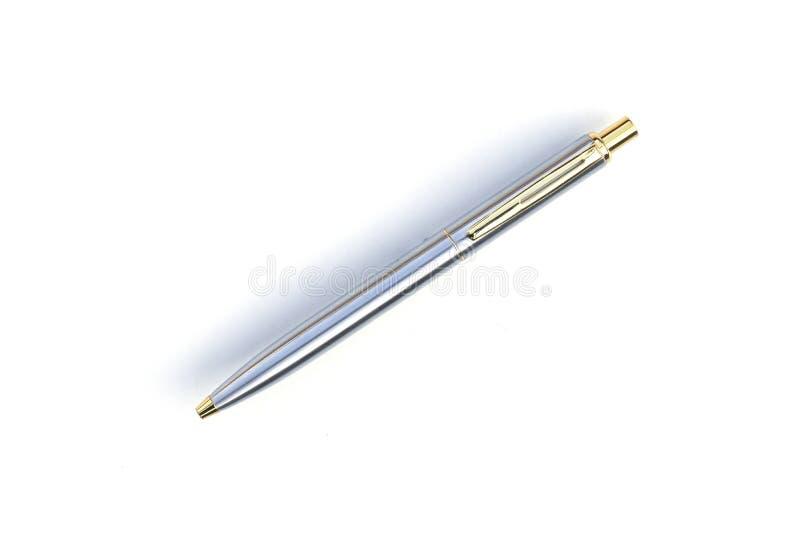 Серебряной предпосылка изолированная ручкой белая стоковые фото