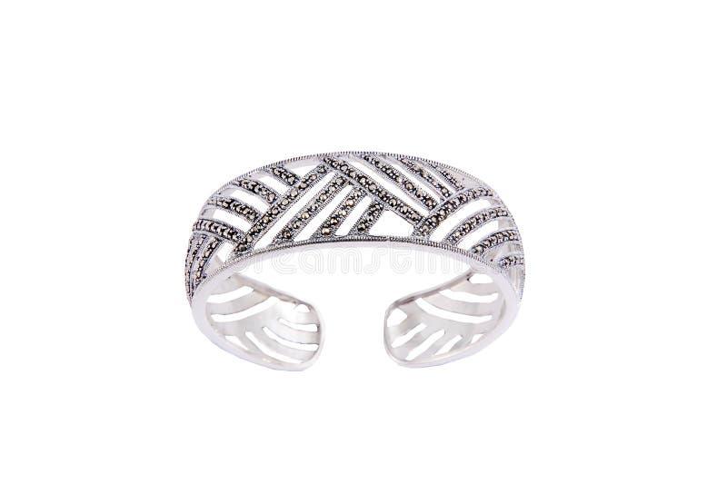 Серебряные браслеты на изолированной белизне стоковое изображение