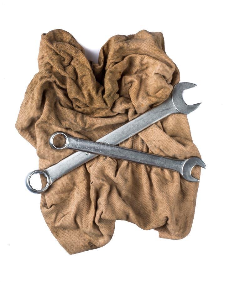 Серебряные инструменты для работы изолированной на белой предпосылке стоковая фотография