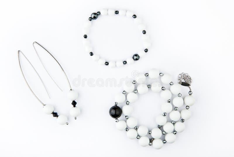 Серебряный браслет серег отбортовывает белый набор камня агата стоковая фотография
