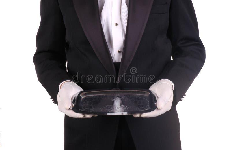 серебряный кельнер подноса стоковое фото rf