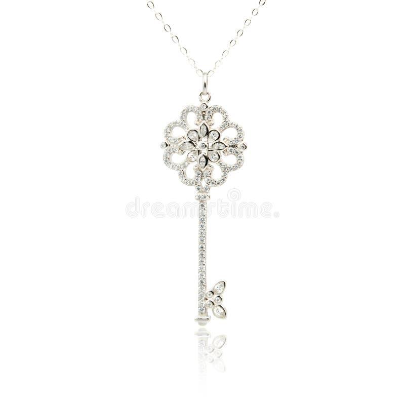 Серебряный шкентель ключа диаманта изолированный на белизне стоковая фотография rf