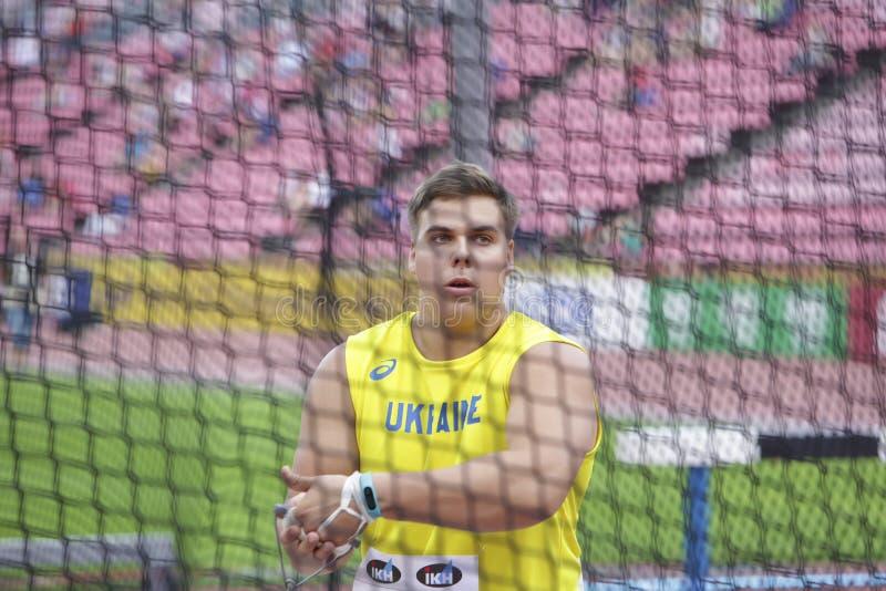 Серебр выигрыша MYKHAYLO KOKHAN в метании молота на чемпионате мира U20 IAAF в Тампере, Финляндии 13 стоковая фотография rf