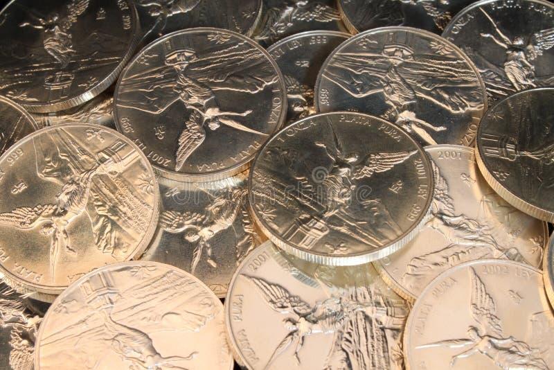 серебр монеток предпосылки стоковые фото