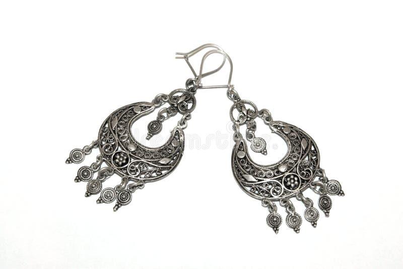 серебр earings стоковые фотографии rf
